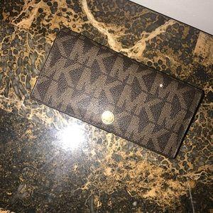 A Michael Kors wallet.